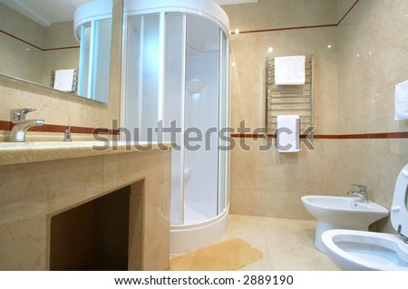 Bathroom with a shower cubicle in hotel - stock photo