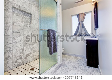 Bathroom with granite tile floor and granite tile wall trim in luxury house - stock photo