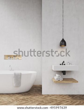 Bathroom with light gray walls, bathtub, sink and towel shelf. Concept ...