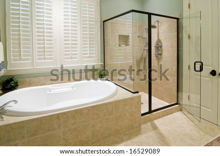 bathroom with shower and whirlpool tub