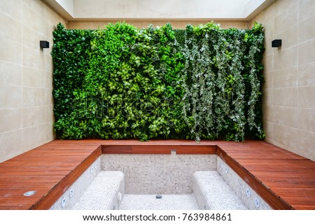 bathroom with wall of plants interior