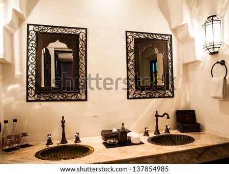 bathroom with wood furniture - stock photo