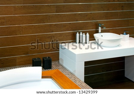 Bathroom with wooden walls and modern basin
