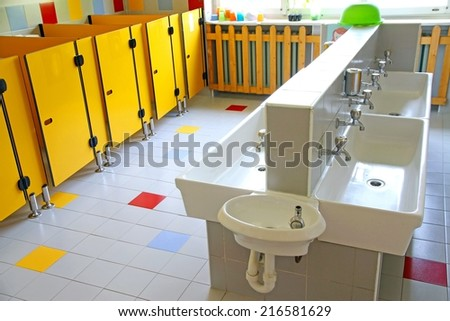 bathrooms and low sinks in a school for young children - stock photo