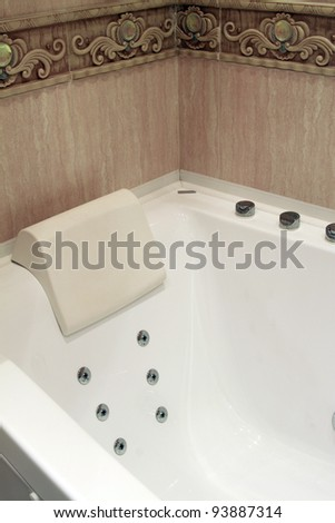 Bathtub in a luxurious bathroom - stock photo