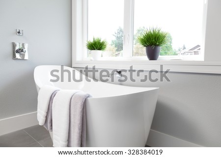Bathtub in master bathroom in new luxury home - stock photo