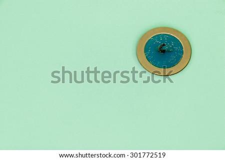 Bathtub plug submerged in azure water taken closeup. - stock photo