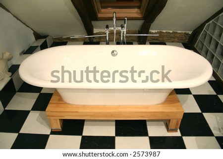 bathtub view on a black and white tile floor