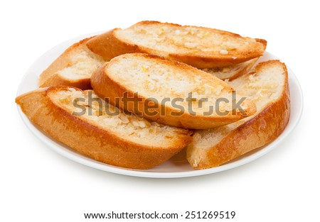 Baton buttered and garlic on a plate - stock photo