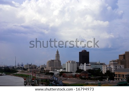 BATON ROUGE, LOUISIANA - AUG 31: Storm clouds of hurricane Gustav move over the Baton Rouge skyline and Mississippi riverfront on August 31, 2008 in Baton Rouge, Louisiana. - stock photo