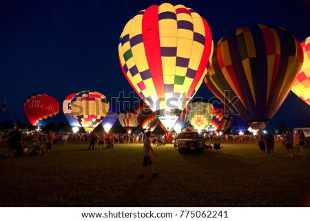 Baton Rouge, Louisiana, USA - 2010: People prepare for the glowing of the balloons at the annual Hot Air Balloon Festival