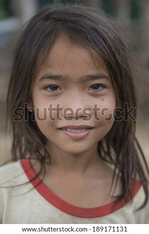 BATTAMBANG, CAMBODIA-APRIL 19: An unidentified Khmer girl smile and poses for a photo on April 19, 2014 in Battambang, Cambodia. Battambang is at the heart of Cambodia's 'rice bowl'.