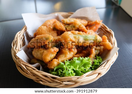 batter fried prawn and vegetable on a table  - stock photo