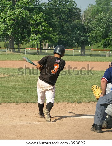 batter swings at pitch - stock photo