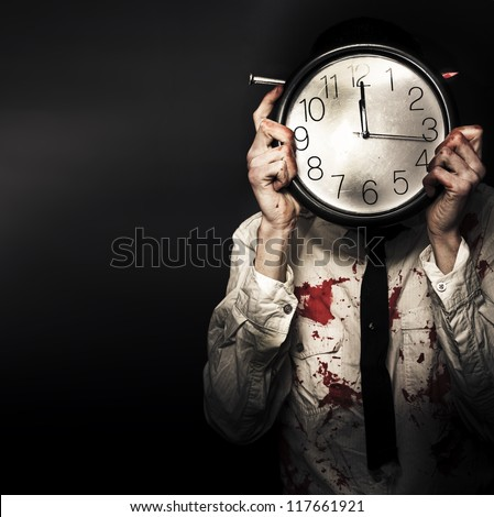 Battered And Blood Stained Business Man Hiding Behind A Clock Face In Countdown Concept Of A Time Deadline - stock photo
