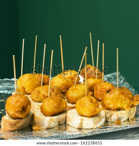 Battered and fried squid, spain food. - stock photo