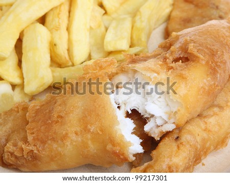 Battered cod fillet with chips - stock photo