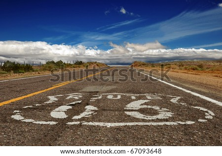 Battered portion of Historic Route 66 in the Mojave Desert, California. - stock photo