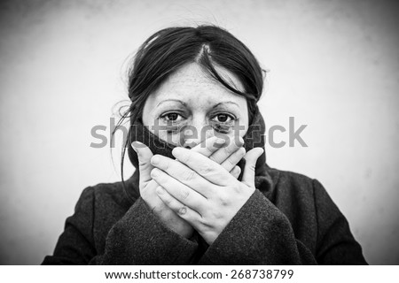Battered woman with eyes damaged, violence against women - stock photo