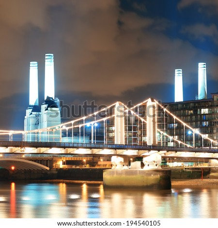 Battersea Power Station over Thames river as the famous London landmark at night. - stock photo