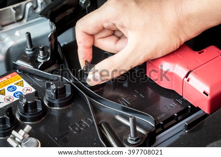 Battery charger and car in auto repair shop