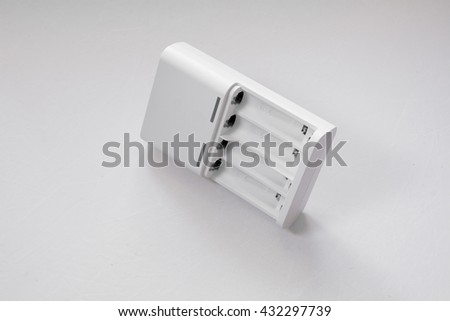 Battery charger on clear background