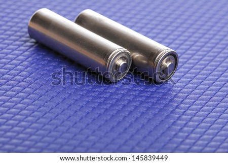 battery Energy supply equipment on blue background - stock photo
