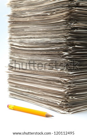 battery of roles and pencil on white fund - stock photo