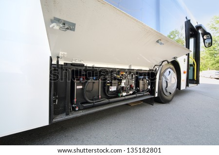 Battery of white city bus with hybrid traction at sunny day outdoor. - stock photo