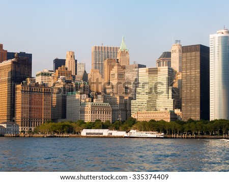 Battery Park and the lower Manhattan Skyline in New York City - stock photo