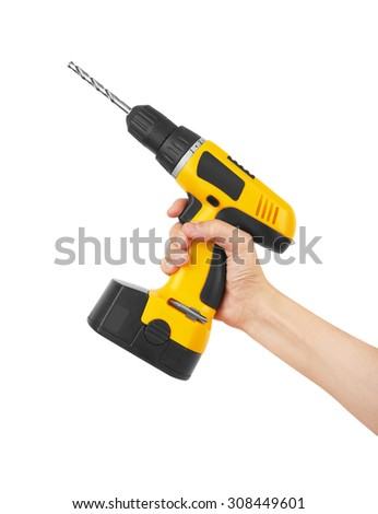 Battery screwdriver or drill on hand, isolated on white background - stock photo