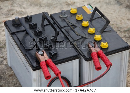 battery with clamps on the contacts  - stock photo