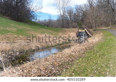 battle creek regional park scenic through forest along trail with stream and dam  - stock photo