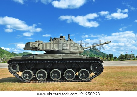 Battle tank with blue sky in background - stock photo