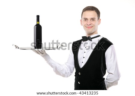 Battler holding a silver tray with wine bottle on it - stock photo