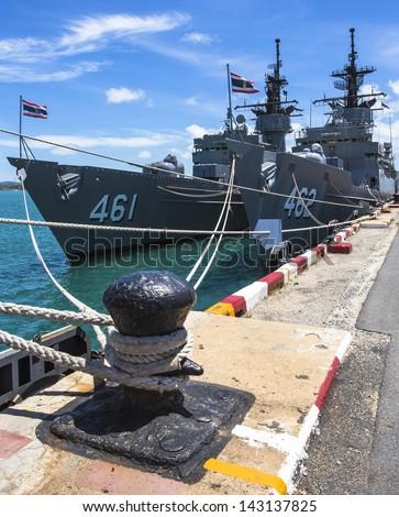 Battleship docked at the harbor - stock photo