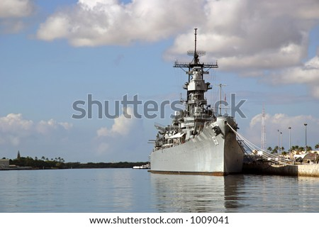 Battleship Missouri Memorial at Pearl Harbor in Honolulu on the island of O'ahu.  Japan surrendered aboard the deck to end WW2. - stock photo