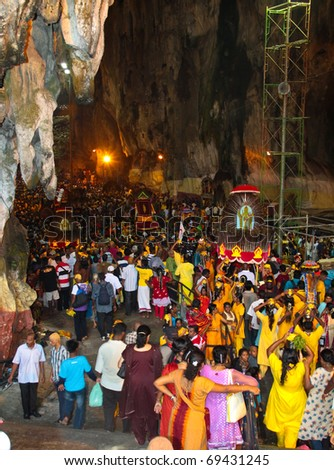 BATU CAVE, MALAYSIA - JAN 20 : Crowd gather inside the cave during Thaipusam festival on January 20, 2011 at Batu Cave temple, Malaysia.