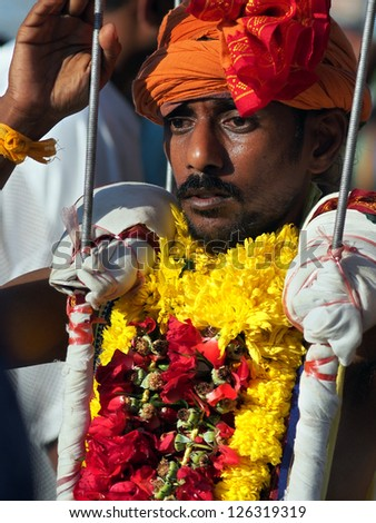 BATU CAVES, MALAYSIA - JANUARY 27:  An unidentified devotee wears an overhead kavadi as offering to Lord Murugan during the Hindu celebration of Thaipusam in Batu Caves, Malaysia on January 27, 2013.