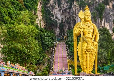 Batu Caves statue and entrance near Kuala Lumpur, Malaysia. - stock photo