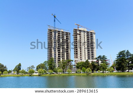 BATUMI, GEORGIA - JULY 10, 2013: Construction site with cranes on blue sky. It is 340 kilometres west of Tbilisi, second largest city in Georgia - stock photo