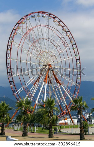 BATUMI, GEORGIA - JULY 20, 2015: The ferris wheel near the sea in Batumi. With a population of 190,000 Batumi serves as an important port and a commercial center.