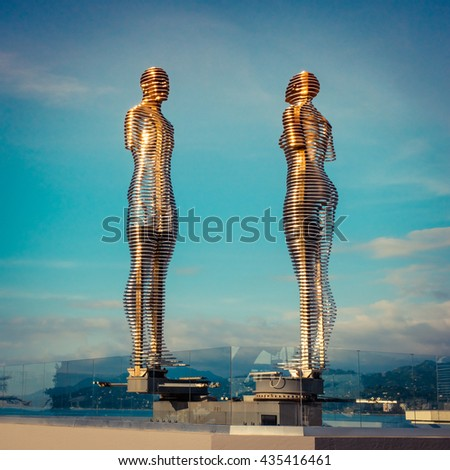 """BATUMI, GEORGIA - JUNE 6, 2016: Moving sculpture """"Ali and Nino"""" by Tamar Kvesitadze in Batumi. Two lovers tell the story of love in the Futurism style, modern mobile sculpture made of metal. - stock photo"""