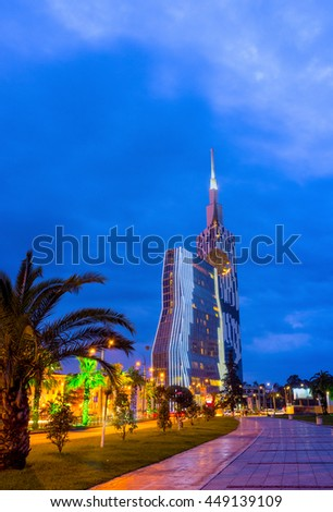 BATUMI, GEORGIA - MAY 24, 2016: The lazy evening walk along the promenade of Batumi with the view on the modern skyscrapers,on May 24 in Batumi.