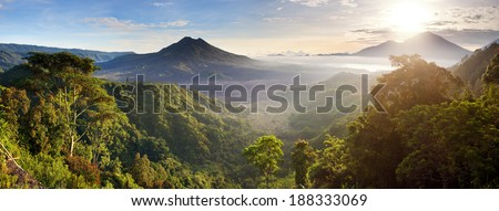 Batur volcano and Agung mountain panoramic view at sunrise from Kintamani, Bali, Indonesia - stock photo