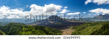 Batur volcano and Agung mountain panoramic view with blue sky from Kintamani, Bali, Indonesia - stock photo