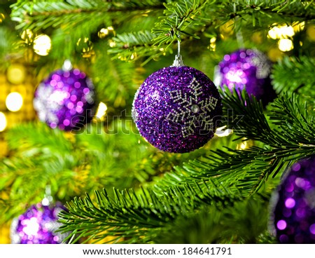 Bauble Ornament in a real Christmas tree in bright color - stock photo