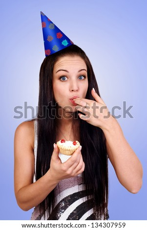 bautiful caucasian girl blowing candles on her cake - stock photo