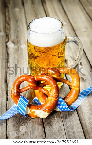 Bavarian Beer and Pretzels with ribbon, Oktoberfest - stock photo