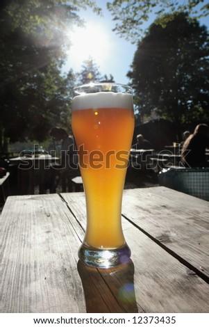 bavarian beer in a beer garden - stock photo